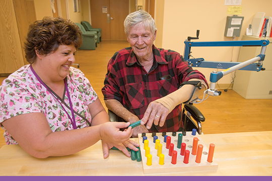 Occupational therapist uses Saebo technology with patient