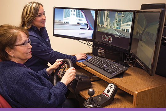 Speech-language pathologist works with patient on pre-driving skills